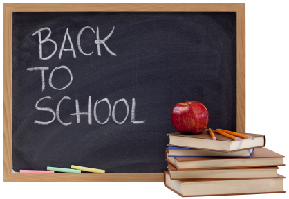 A back chalkboard with a white lettering on it saying, 'back to school'.